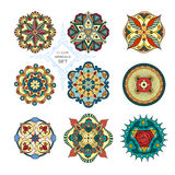 En uppsättning av nio mandalas stock illustrationer