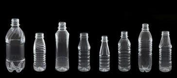 En uppsättning av olika plast- flaskor royaltyfria bilder