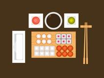 En uppsättning av sushi, japansk mat på en träplanka i plan design också vektor för coreldrawillustration Arkivfoto