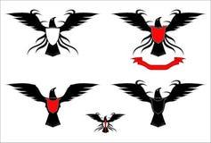 En uppsättning av svarta Eagles, fördelade ut vingarna royaltyfri illustrationer