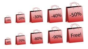En uppsättning av tio röda ökande format av pappers- påsar för köp med rephandtag och rabatter av 10, 20, 30, 40, 50, 60, 70, 80, Arkivfoto
