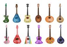 En uppsättning av härliga ukulelegitarrer på vita Backgr Royaltyfria Bilder