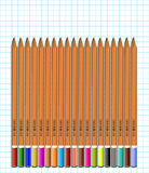 En uppsättning av kulöra blyertspennor på papper i bur vektor Royaltyfria Bilder