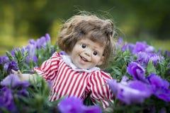 En uttrycksfull docka Arkivfoton