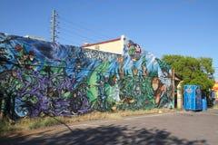 En väggmålning som försäljningsbefordran eller: Trollkarlen av AZ Arkivbild