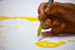 En väggmålning som målas på kanfas av en indisk konstnär fotografering för bildbyråer