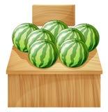 En vattenmelonställning med en tom träskylt Royaltyfri Foto