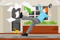 Affärsman som halkar på en tillfällighet Arkivfoton