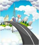 En väg som går till staden Arkivfoto