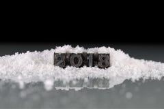 2018 en viejas letras de molde del metal en la nieve Fotografía de archivo libre de regalías