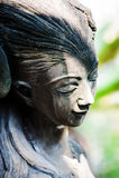 En vila staty i mjukt ljus arkivfoton