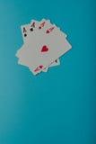 En vinnande pokerhand av fyra överdängare som spelar kort Royaltyfria Foton