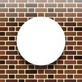 En vitbokcirkel mot en tegelstenvägg också vektor för coreldrawillustration Arkivfoto