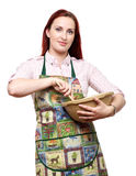 En vrouw die koken bakken Stock Afbeeldingen