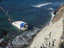 En yacht aground på en rev i det karibiskt