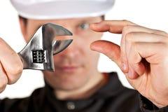 Ha på sig för Handyman som är enhetligt, och hardhat royaltyfri foto
