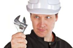 Ha på sig för Handyman som är enhetligt, och hardhat fotografering för bildbyråer