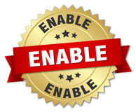 Enable round isolated badge. Enable round isolated gold badge Royalty Free Stock Photo