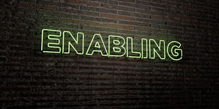 ENABLING -Realistic Neon Sign on Brick Wall background - 3D rendered royalty free stock image Royalty Free Stock Image