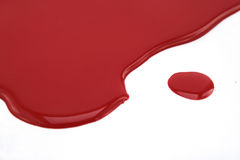 Enamel. Red enamel and brush isolated on white Royalty Free Stock Image