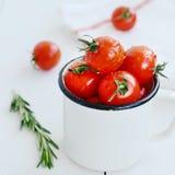 Enamel bowl full of ripe cherry tomatoes Royalty Free Stock Photo