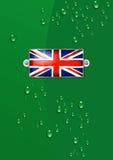 Enamel British Union Jack Flag - Background. Side of a British Racing Green Car with an Enamel British Union Jack Flag attached Stock Photo