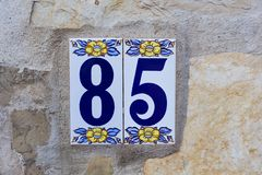 Enamel ceramic house number eighty five close-up stock photography