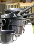 Enamel Cookware. Sits on vendors table (room for text on white table area royalty free stock photos