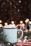 Cocoa with Marshmallows and Candy Canes with Falling Snow Stock Photo