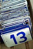 Enamel number plates with thirteen in front Royalty Free Stock Photo