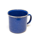 Enamel Tin Cup. Blue Enamel Tin Cup from low perspective isolated against white background stock photography
