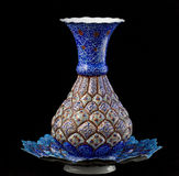 Enamel vase. Enamel persian vase with plate on black background Royalty Free Stock Photo