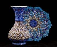 Enamel vase with plate. Enamel persian vase with plate on black background Stock Image
