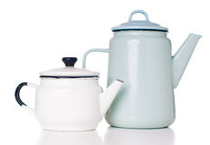 Enameled coffee pots. Two different vintage enameled coffee pots, white and blue, isolated on white background Royalty Free Stock Photos