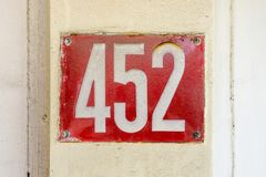 House number four hundred and fifty two 452. Enameled house number four hundred and fifty two 452 Stock Image