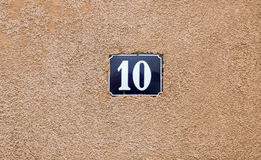 Enameled house number ten. Blue lettering Stock Photo