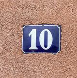 Enameled house number ten. Blue lettering Royalty Free Stock Photography
