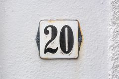 House number  20. Enameled house number twenty 20 Royalty Free Stock Images