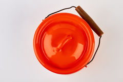 Enameled lidded jug isolated. Red jug for milk, white background Stock Images