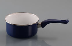 Enameled pan with handle. On gray background Stock Image