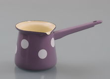 Enameled pot with handle. For making Turkish coffee Royalty Free Stock Photo