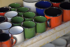 Enamelled aluminum mugs Royalty Free Stock Photos