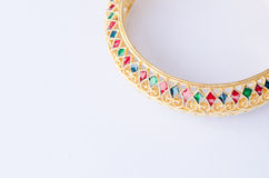 Enamelled gold bangle. On white background Royalty Free Stock Photography