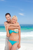 Enamored couple on the beach Stock Photos