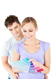 Enamored couple choosing color for a room stock image