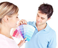 Enamored couple choosing color for a room Royalty Free Stock Images