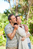 Enamored couple in the garden Stock Images