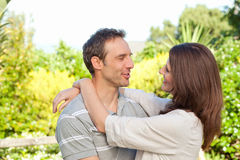 Enamored couple in the garden Royalty Free Stock Photography