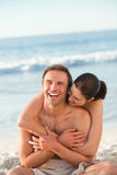 Enamored couple hugging on the beach Royalty Free Stock Photography