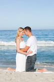 Enamored couple kissing at the shore line Royalty Free Stock Photo
